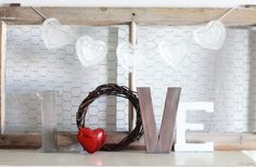 valentines day love letters mantel decor using letters, a grapevine wreath and a sequin heart.