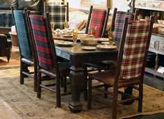 Plaid dining chairs ~ create a very rustic feel to this dining room