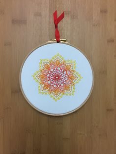 Mandala Indian sunshine embroidery hoop art - red, orange, yellow on white