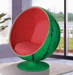 I feel like this is a feminine chair. It's a watermelon chair that is in a sphere form and the entrance is a circle shape and it's curved as well.