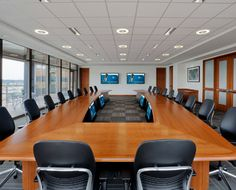 Executive Boardroom | Cricket Communications | Audio visual installation includes LCD displays, audio and videoconferencing system, tabletop microphones and wall-dock touch panel. CompView.com