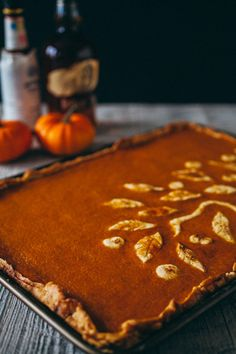 A giant 9x13-inch pumpkin slab pie, made with bourbon, bitters and orange zest for an old fashioned take on a Thanksgiving favorite.