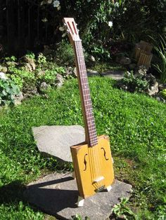 DIY Cigar box guitar. Perfect for some front-porch pickin' on a Sunday afternoon.