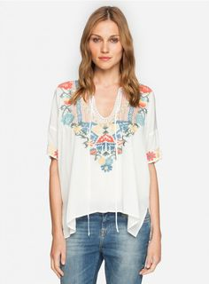 Pangaea Blouse The BIYA PANGAEA BLOUSE adds a boho touch to the staple t-shirt silhouette thanks to a relaxed fit in flowy rayon adorned by a spring appropriate embroidery design in subtle hues. Embrace the boho style as you pair the PANGAEA BLOUSE with printed pants and sandals!  - Rayon - Keyhole Tie Front, Short Sleeves, Split Hem - Signature Embroidery - Care Instructions: Machine Wash Cold, Tumble Dry Low - Cut for a Relaxed Fit