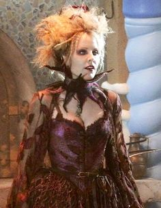 The blind witch from the story of hansel and gretel ..... Emma caulfield who played Anya the ex demon on Buffy the vampire slayer plays the witch. Love her costume, hair and makeup!