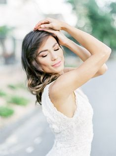 423df364 Bride wearing a Marchesa Daffodil sleeveless gown with glamorous waves in  her hair and soft bridal