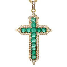 Estate Betteridge Collection Victorian Emerald & Diamond Cross Pendant the crucifix centering on 13 square-shaped emeralds weighing approximately 24.00 total carats, with a diamond-set fringe and bale consisting of 102 old mine cut diamonds weighing approximately 16.20 total carats, mounted in yellow gold, circa 1870