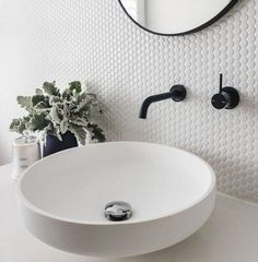 Ready to revamp your bathroom decor?We especially like wall-mounted bathroom faucets because they create extra countertop space, and they work whether you have a snug washroom or a large one. #hunkerhome #bathroomfaucet #wallmountedfaucet #faucetideas #bathroomfaucet Downstairs Bathroom, Bathroom Renos, Bathroom Flooring, Bathroom Faucets, Bathroom Ideas, Bathroom Backsplash Tile, Penny Backsplash, Small Bathroom Tiles, Vessel Sink Bathroom