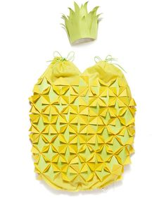 DIY Pineapple Costume | These homemade Halloween costumes, suitable for adults and kids alike, are just right for couples, siblings, families, or friend groups. And you'll have to do minimal shopping to throw each of these looks together—all of the costumes are made with items you can find around the house. So grab your craft supplies and get to work.