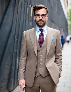 Dan Rookwood in a Reissthreepiece suit andRalph Lauren Polo glasses.