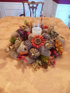 This 21 centerpiece will be a beautiful addition to your festive Thanksgiving table! It features leopard ribbon, beautiful fall sunflowers, gold and leopard balls and touches of burlap! **This listing does not include the candle or hurricane lamp** Deco Mesh Crafts, Wreath Crafts, Deco Mesh Wreaths, Diy Wreath, Holiday Wreaths, Burlap Wreaths, Wreath Ideas, Thanksgiving Centerpieces, Thanksgiving Wreaths