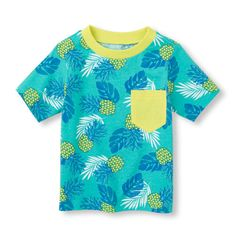 A bright pineapple print and pop of yellow on the collar and pocket make this shirt a must for summer!