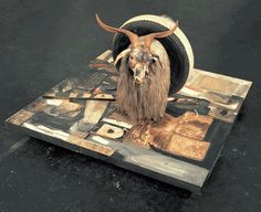 Robert Rauschenberg. Painting on the floor with animal and tire. Very cool.