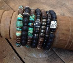 Beautiful, Earthy Central Mexican Turquoise barrel bead accents a row of 8mm coconut wood and natural Turquoise Heishi beads. These earthy beads are lined throughout a sturdy stretch cord that will slide to your wrist with ease. This cool accessory can be worn on its own or stacked to