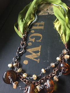 Necklace with vintage silk ribbon, copper and silver [chain, wire, findings], glass and gemstone beads. Glass Jewelry, Beaded Jewelry, Silk Ribbon, Green And Gold, Gemstone Beads, Beading, Jewelry Making, Jewels, Gemstones