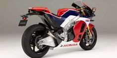 "Honda has revealed a production-ready, road-going version of its racing bike. The latter has won MotoGP championships for two seasons in a row in 2013 and Dubbed the and described by Honda as the ""Absolute MotoGP Machine for the Street"", the […] Motos Honda, Honda Bikes, Honda S, Honda Fireblade, Marc Marquez, Motorcycle Paint Jobs, Motorcycle Style, Grand Prix, Honda Powersports"