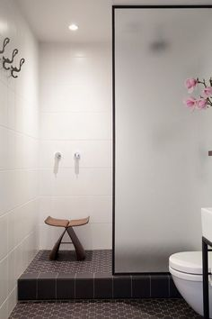 White bathroom wall tile, dark floor tile, simple simple simple - need a little storage spot tho