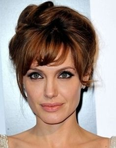 angelina jolie bridal updo hairstyle with side bangs
