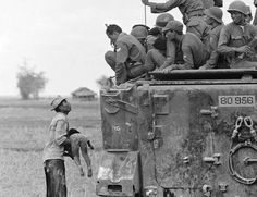 This photo, taken by Horst Faas, shows a father as he holds the body of his child as South Vietnamese Army Rangers look down from their armored vehicle March 19, 1964. The child was killed as government forces pursued guerrillas into a village near the Cambodian border. It won Faas the Pulitzer Prize for Photography in 1965.