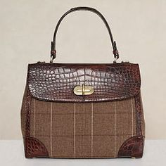 MEDIUM PLAID WOOL TIFFIN BAG $15000.00 Handcrafted in Italy and finished with brown crocodile trim, this loden-hued wool bag complements the menswear-inspired tailoring of our Fall Collection. Its structured satchel silhouette and signature turn-lock closure exude timeless sophistication, while a removable shoulder strap provides modern versatility.