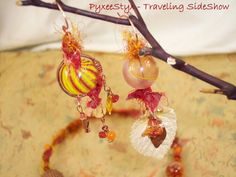 May The Wings Of The Butterfly Kiss The Sun - mismatched chandelier earrings - hollow Carnival swirl glass with gemstone dangles #PyxeeStyx #TravelingSideShow # SRAJD