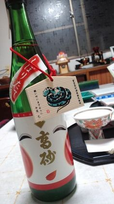 2013 New Year's Special Sake Bottle with an Ema Wooden Wishing Plaque (Otafuku Lucky Lady Lable) |高砂の初しぼり酒