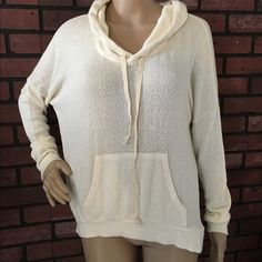 Brandy Melville pullover hoodie sweater OS Cream colored, very soft, oversized pullover with a hood. One size. No stains or wear noted. Really great pre-loved condition. 58% cotton, 42% viscose. Super soft and cozy!!! Brandy Melville Sweaters