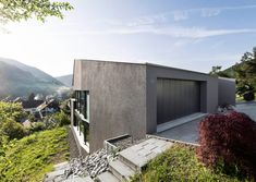 Single family house built on a steep slope that leads to the centre of a village - CAANdesign | Architecture and home design blog