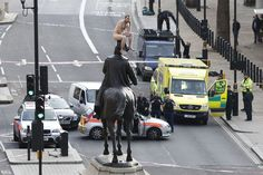 An unidentified man sits naked on top of the statue of Prince George, Duke of Cambridge outside the Ministry of Defence building in Whitehall in central London on Nov. 23. The man, who brought Whitehall to a standstill for almost two hours, stood naked on the statue and struck various poses before being eventually talked down. (Justin Tallis/AFP/Getty Images) #