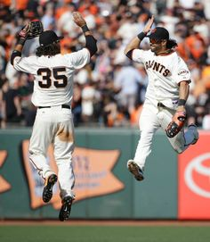 "4/8/14. Brandon Crawford and Angel Pagan (aka, ""The Best Hair in MLB"") go airborne."