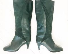 Classy forest green leather and suede knee high boots with heels. Size 7.5.
