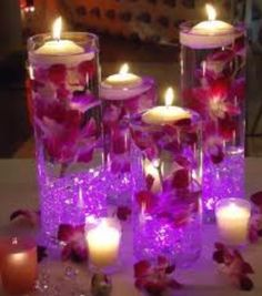 Will be my center pieces but with dark purple orchids.