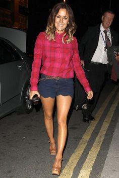 Pin for Later: Caroline Flack Has a Signature Look, and She's Not Ditching It Anytime Soon Scalloped denim shorts and a checked shirt showed off those tanned legs after a busy day at the X Factor Bootcamp in 2012.