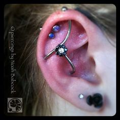 Three point #industrialpiercing with jewelry by #industrialstrength (at Evolution Piercing)