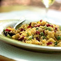 Curried Couscous Salad with Dried Cranberries | MyRecipes.com To make the dressing, I use three tablespoons Orange Juice and omit the water/OJ Concentrate. Also, only use 2lg cloves garlic or 3-4small ones as it can overpower the salad pretty fast.