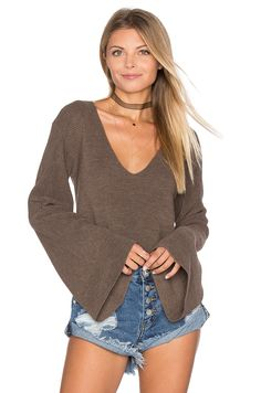 Pair this Free People sweater with jeans and over the knee boots for a chic daytime look