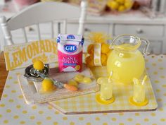 Perfect for your country kitchen or cottage summer scene, this miniature lemonade set comes with everything shown including a glass pitcher of