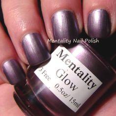 Mentality Nail Polish - Glow, a blackened red-toned purple metallic creme nail polish, dries to a satin finish.