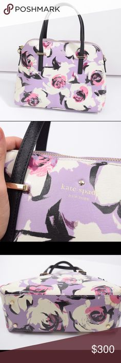 Kate Spade lavender rose printed shoulder bag Lovely feminine shoulder bag from Kate Spade. Gorgeous lavender purple & rose pink floral pattern. Sturdy, coated polyurethane with black leather trim. 100% authentic. Nice, medium-large size. Absolutely perfect condition. No dustbag. kate spade Bags Shoulder Bags