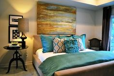 Style Love: Turquoise, gold, and wooden tones make up a gorgeous bedroom.