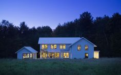 MODERN FARMHOUSE by @TruexCullins Architecture  This custom home is situated in Jericho, Vermont on the edge of a small meadow. The house is a three part composition of garage, studio and home placed about a parterre garden. In the tradition of Frank Lloyd Wright, the house is a grid formed composition striving to generate economy from the beautiful elegance of formed geometry. The structures utilize modest exterior materials to shape a traditional but elemental form in the landscape.