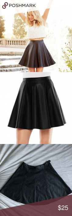 LC Lauren Conrad Faux-Leather Circle Skirt Versatile faux-leather skirt, unlined with back zipper. Missing button is attached and can be easily sewn back in place. LC Lauren Conrad Skirts Circle & Skater