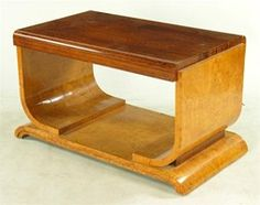 A French Art Deco coffee table,  the rosewood top on ash curved supports and…
