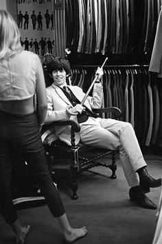 """Suiting Up (1964)    """"The day before, we had appeared on Dean Martin's TV show,"""" Keith Richards explains of this shot. """"He was sarcastic when he introduced us: 'These long-haired wonders from England, the Rolling Stones… They're backstage picking the fleas off each other.' Next morning we all went shopping for clothes with [manager] Andrew [Loog Oldham].""""    Via rollingstone.com"""