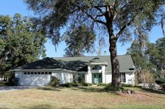 Immediate occupancy in this spacious 4 bedroom  2 bath home. Volume ceilings with skylights for natural lighting. Split bedroom plan. Family room with brick fireplace. Wood floors throughout. Eat in kitchen, hard surface counter tops and stainless appliances. Cabinets with plenty of drawers and pull outs. Formal dining room. Master Bedroom has access to screened enclosed Lanai. Walk in closet, bath with tub plus jets, separate shower and dual vanity. Indoor laundry with sink and…