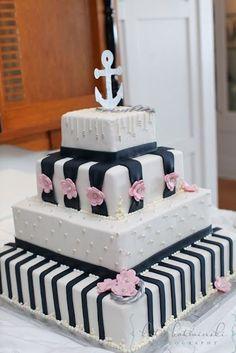 Nautical themed wedding cake with pink flowers and an anchor on top #wedding #weddingcake #nautical #cake #blackwhite
