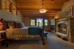 Yes! Fireplace in the bedroom! Rustic Guest Bedroom - Found on Zillow Digs