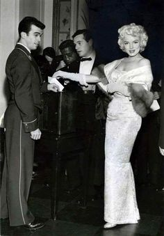 Marilyn with Milton Greene at the premiere of East of Eden, March 9, 1955.