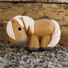 palomino painted clay horse. $15.00, via Etsy.