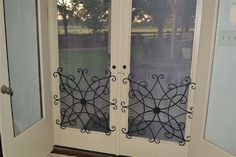 """the problem: how to (stylishly) protect screens from being pushed out and hole-poked"""" by big hands, little hands, and other body parts as well as from pets...the solution:  decorative ironwork that's meant to be hung on the wall as screen protectors"""